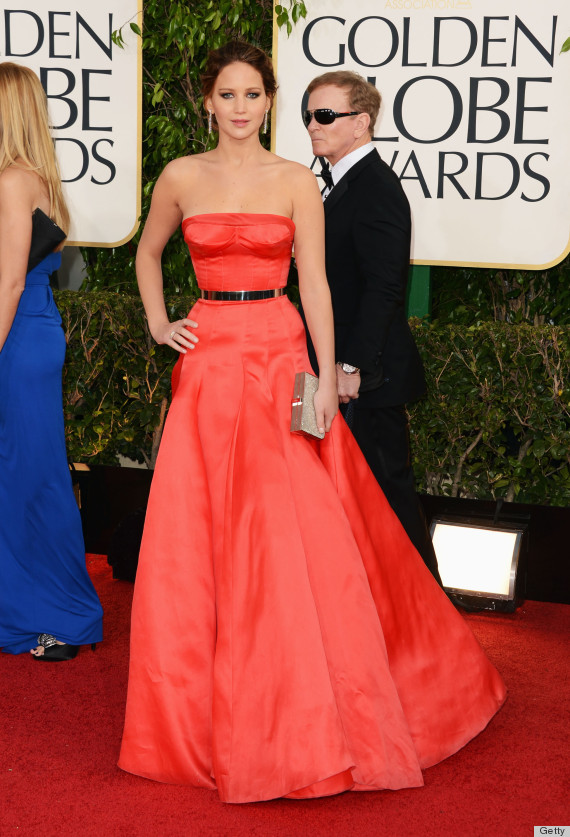 Jennifer Lawrence in her tangerine-red couture gown and slim black belt